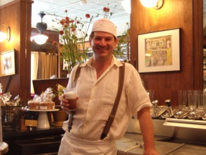 Brooklyn Farmacy proprietor Peter Freeman poses with an egg cream