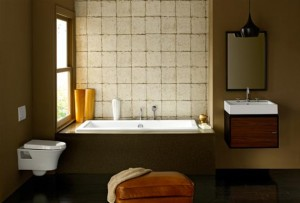 A bathroom suite displaying fixtures and furniture from the Porcher Solutions collection.